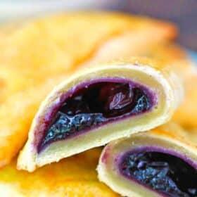 blueberry hand pie sliced in half