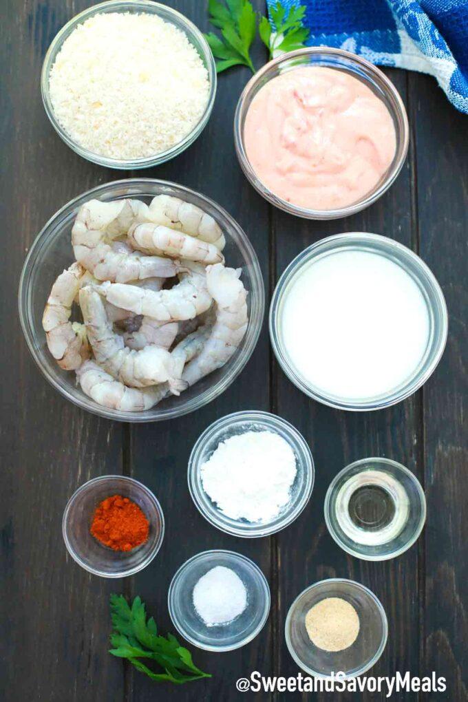 air fryer bang bang shrimp ingredients in individual bowls on a table