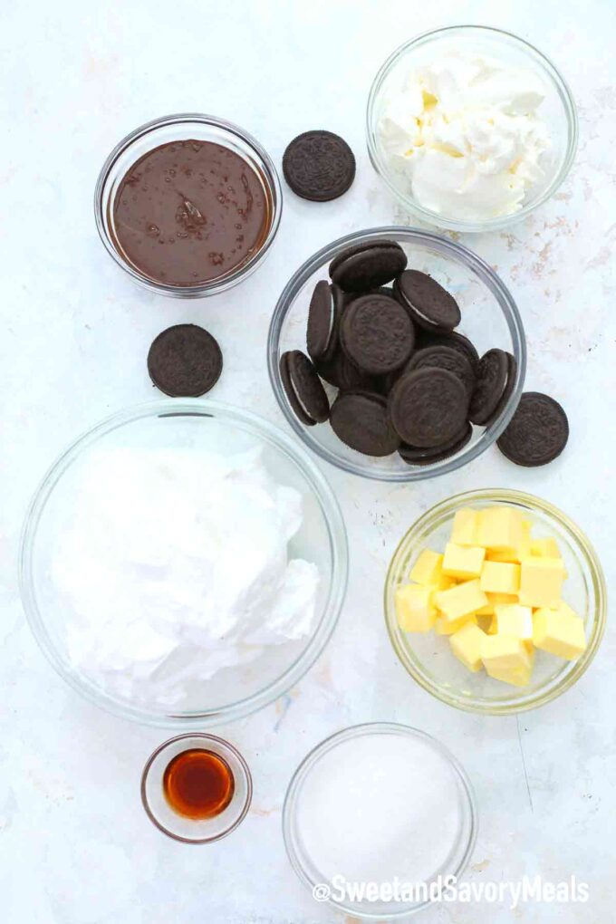 oreo pie ingredients in small bowls on a table
