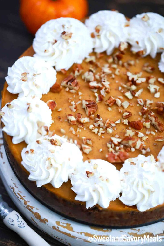 pumpkin pie with whipped cream and pecans