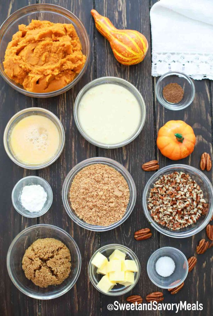 pumpkin pie ingredients in individual bowls on a table
