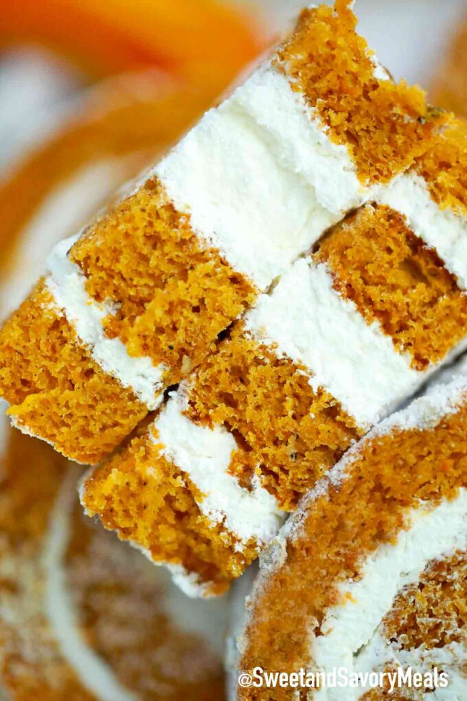 a slice of pumpkin roll with cream cheese frosting