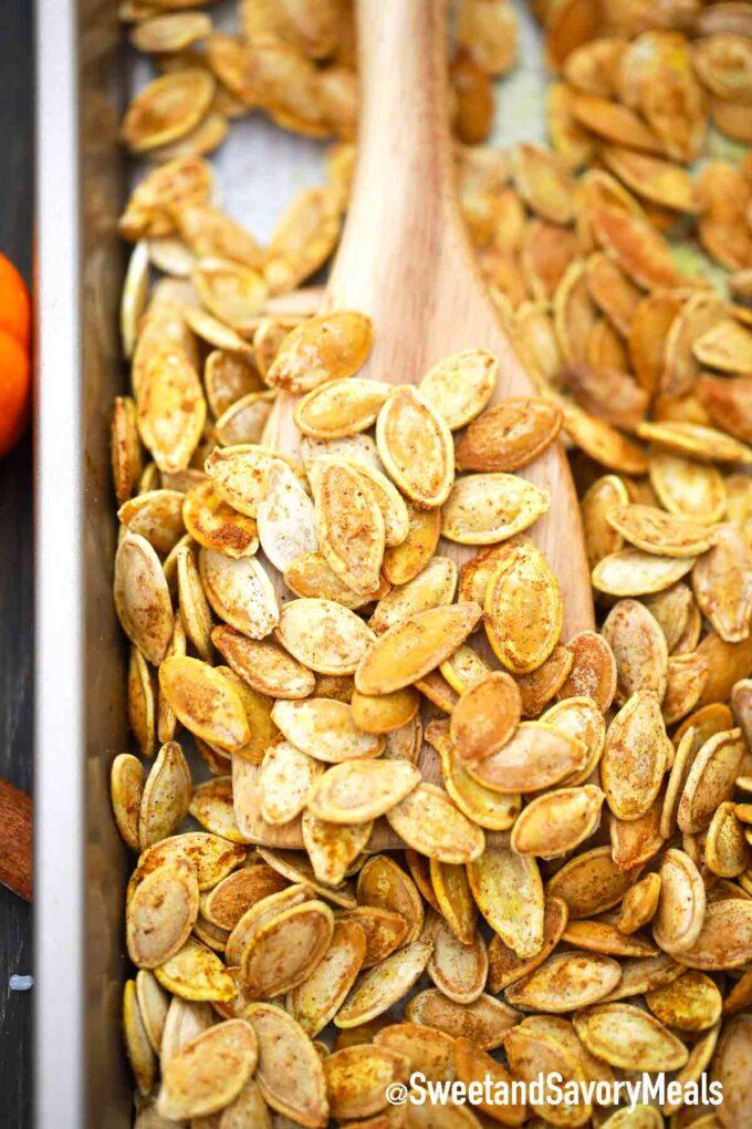 roasted pumpkin seeds on a baking sheet